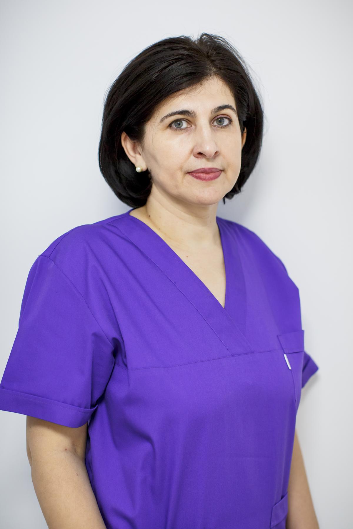 http://dentalplus.ro/wp-content/uploads/2015/11/dr-Doina-Popovici.png