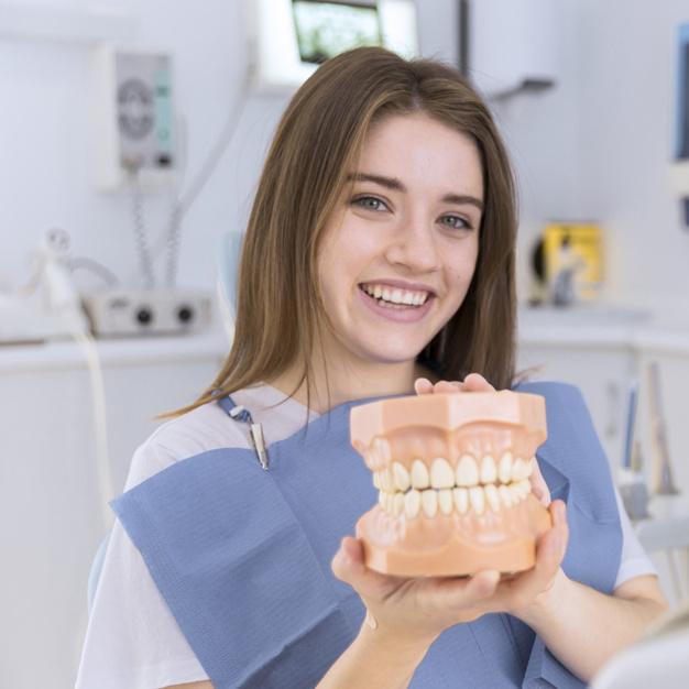 http://dentalplus.ro/wp-content/uploads/2016/04/portrait-of-happy-young-woman-holding-denture-in-her-hands_23-2147879140.jpg